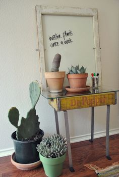 Dry Erase Board in a Vintage Window. Best part is the table made of a soda box and glass (and legs