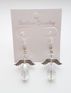 Cute Angel earrings. Made with 925 silver ear hooks and glass beads.