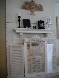 Old Shutters turned Fireplace Screen; I want this for my fireplace. Diy Fireplace Mantel, Fireplace Cover, Fireplace Screens, Fireplace Ideas, Mantle Shelf, Fireplace Pictures, Mantle Ideas, Old Cabinet Doors, Old Cabinets