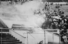 Lima National Stadium riot. May 24, 1964. Lima, Peru. Peru had high hopes of filling one of the top two spots that would ensure their place at the Tokyo Olympic Games. A disallowed goal sparks one of the worst riots ever witnessed at a sports event. Two fans run onto the pitch to attack the referee, and many more surge forward. The police, who were greatly outnumbered respond by firing teargas. The scene rapidly desended into chaos. The crowds started fires in the stands and began smashing…