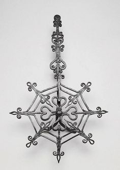Revolving grill, France, ca. 1700. Wrought iron decorated with hearts and fleur de lys.