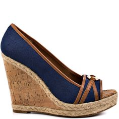 Find pure bliss in this resort ready wedge from Ivanka Trump.  Lark features a deep blue fabric upper with leather ornamentation and a dazzling logo charm featured at the vamp.  Espadrille borders the 4 1/2 inch cork wedge and 1 inch platform to leave you with a vacation appropriate sandal.