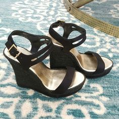 "Black platform wedges Like new! 4.5"" wedges will give you some height! But it feels like 4"" with the platform.  I only used it once to a wedding. Very slight wear on the bed of the shoe where I removed my insole sticker.  Thanks for looking!  Michael Antonio Shoes Wedges"
