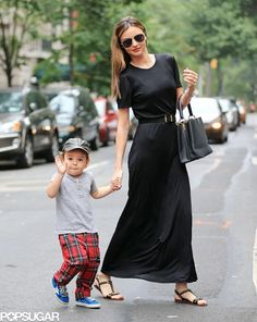 Miranda Kerr With Flynn Bloom Waving in NYC (Awwwww).