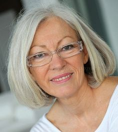 Classic bob for grey hair - Judith. Great glasses, contemporary frame and clear so it is not heavy or overpowering.