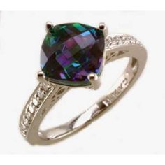 #sparkle   Rainbow topaz and diamond ring with 0.14ct tdw and 8mm cushion rainbow topaz in 14k white gold   www.hannoush.com