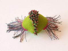 Yael Krakowski brooch. felt, beads, silk threads.