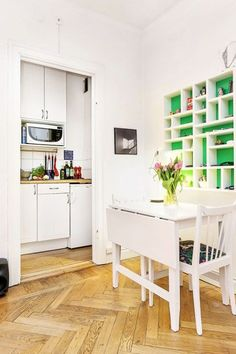 This Teeny-Tiny Apartment Had Us At The Green Shelving #refinery29  http://www.refinery29.com/living-in-a-shoebox/20#slide-9  The foldable dining table is a huge space-saver. Related: You're Going To Wish You Could Stay In This Guest House