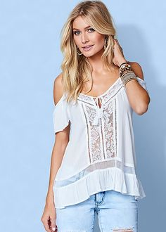 Keep it soft and sweet in the Venus lace cold shoulder top.