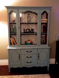 Painted out this old hutch and added wallpaper to the interior-now it's shabby chic and beautiful!