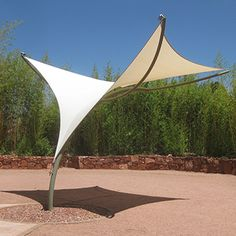 Tensile Shade Products, LLC is a producer of pre-engineered tensile sculpture products. Our line of tensile sculpture products include Sunbird, Sunbow, Sunami and Eclipse. Car Canopy, Patio Canopy, Canopy Outdoor, Backyard Shade, Outdoor Shade, Patio Shade, Canopy Architecture, Landscape Architecture, Landscape Design