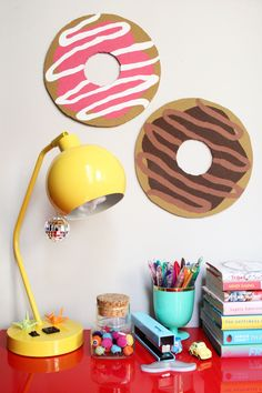 DIY Donut Bulletin Board w/ Sprinkle Push Pins - Paint the Gown Red  But I also think you could use a DVD but it would be smaller