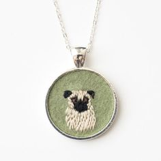 Embroidered pug necklace