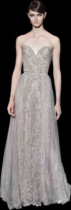 Elie Saab 2014 Haute Couture | Silver sweetheart shaped embroidereddress with embroidered panels on skirt with belt. | So gorgeous.