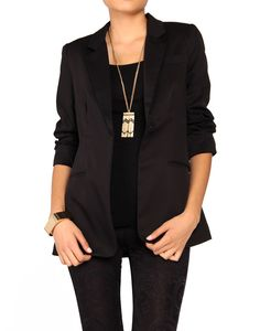 black blazer, statement necklace.