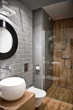 Love how the wood looking tile floor extends into the bathroom without a curb in the shower