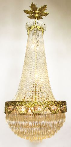 A Fine French 19th/20th Century Louis XVI Style Gilt-Bronze and Cut-Glass Beaded Cascade Ten-Light Chandelier with Garlands and a Crown Top with a Floral Canopy. Circa: Paris, 1900