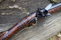 ".40 Caliber Isaac Haines Youth Rifle Custom Made by D.K. Lisle. Lancaster County, PA Flintlock Longrifle (RH) (Isaac Haines), .40 Caliber. ""A"" Weight Swamped 38"" Barrel (Round bottom rifled), Grade 5 Curly Maple Stock, LOP Approximately 12 3/8"", weight 6 lbs"