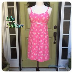 """Lilly Pulitzer Dress HP 3/23, 6.17, 7/10 Lilly does it again and again with her beautiful summer colors and her soft cotton fabric! This dress is adorable. Green, orange and blue floral against a pink background. Body of dress is 25 1/2"""" long plus adjustable straps. Fully lined and 100% cotton! You need this dress! Host pick by charms245 and harperchic beccascloset88 Lilly Pulitzer Dresses"""
