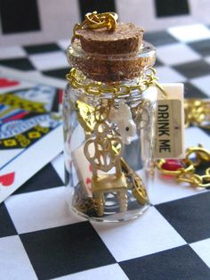 Fall Down the Rabbit Hole - Steampunk Alice in Wonderland necklace. $26.00, via Etsy.