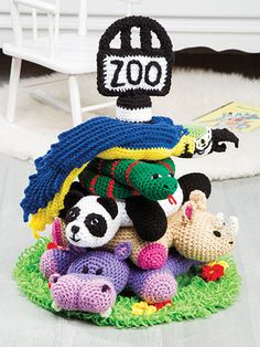 This adorable set of stackable zoo animals includes the pole, a hippo, a rhino, a panda, a snake and a parrot. Each design is made using worsted-weight yarn and stuffed with fiberfill. Also needed is