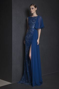 Ready To Wear Spring Summer 2015    Style 12 Midnight Blue evening gown in draped Georgette and one shoulder ruffled sleeve, with embroidered Tulle on one side.