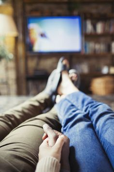 Personal perspective affectionate couple holding hands watching TV in living room Emotional Movies, Hidden Movie, Couple Holding Hands, Hold Hands, Classic Comedies, Tv Watch, Movie Dates, Tv Couples, Comedy Tv