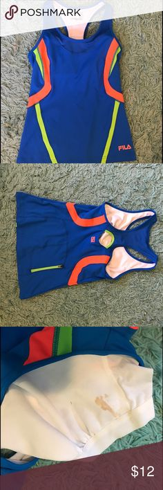 Fila running tank top Super cute, vibrant tank top! I've only worn it once but it was just too small. There is built support and a pocket in the back! On the built in sports bra there is a small stain, but it is not visible when you're wearing it. Fila Tops Tank Tops