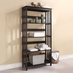 Organize your favorite books, magazines and DVDs or proudly display decorative pieces and knick-knacks with this wood bookcase. Finished in dark espresso, this five-tier display piece features stylish slat designs on the sides.