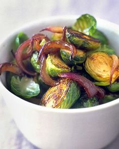 Brussels sprouts become mild, tender, and nutty when blanched and then sauteed over high heat. Sweet and tangy balsamic-glazed red onions provide a nice contrast of flavors and color.