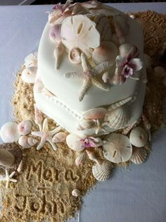 seashore wedding cakes  - Add some seaside fun to your special day with these seashore wedding cakes from 'Let Them Eat Cake,' a custom cake-designing boutique i...