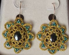 Hematite      Decided to bling this pair of Tatsmithed earrings with a few beads.  They were tatted with two strands of gold sewing thread and are for sale on West Pine Creations.