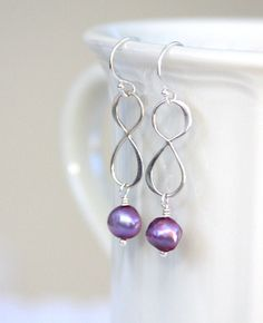 Earrings sterling silver wire wrapped infinity by HollyMackDesigns, $36.00
