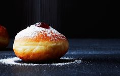 The best thing about Hanukkah? Pillowy, deep-fried sufganiyot filled with strawberry jelly.