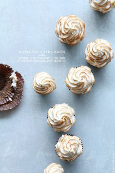 Banana Cupcakes with Bourbon Butterscotch Filling and Toasted Marshmallow Frosting via @bakersroyale/ // #banana #marshmallow #bourbon #butterscotch #recipe #Overripe