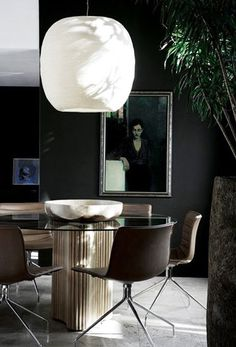 Dark dining room with art.