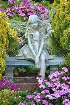 A fairy watches her garden