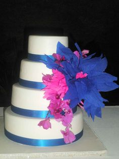Wedding Cakes: Pink and blue flowers wedding cake with blue ribbon