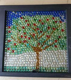 Glass gems glued on an old window. I used E6000 glue.