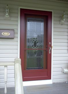 After picture - Customer chose the Provia full length textured steel entrance door with the walnut woodgrain stain, solitaire decorative glass with zinc caming. Provia's Model #396, One Lite storm door in mountain berry red was also installed. — in Phillipsburg