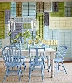I love this! LOVE the shuttle wall in multi-color and the color palette. Love the white table and miss-matched chairs in the same blue color.