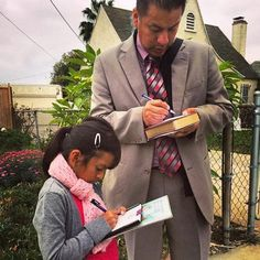 Father, Like Daughter, taking notes out in the ministry.