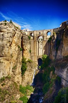 Andalusia - Spain, The Puente Nuevo is the newest and largest of three bridges that span the 120-metre-deep chasm that carries the Guadalevín River and divides the city of Ronda, in southern Spain. Wikipedia