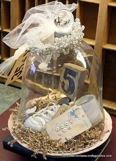 Baby Shoes under Cloche  |  http://www.craftygoodies.com/2012/02/junkin-finds.html