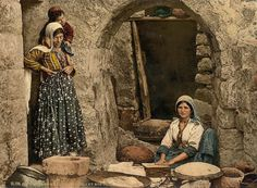 'Syrian women making bread'. This color photochrome print was taken between 1890 and 1900.
