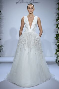 Love this! Very modern and glamorous! Courtesy of Kleinfeld Bridal -Cosmopolitan.com