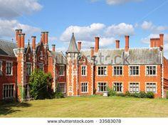 Historic English manor House and Gardens - stock photo