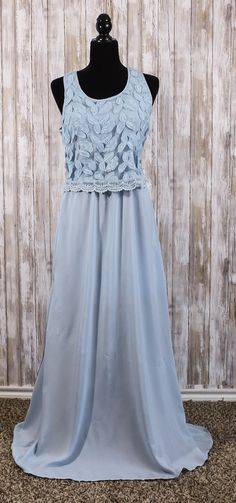 Light blue, long skirt #dress, featuring a #lace bodice. Zippered up side and lace back.