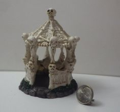 Even fairies like to celebrate Halloween! This will be sure to spook the visitors! This gazebo measures 3 1/2 inches tall and 2 1/2 inches wide. This is made from clay resin.