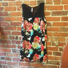 """NWT Xhilaration floral tunic sz L Brand: Xhilaration Type: Tunic Size: L Fabric: Upper panels- base fabric 100% nylon embroidery 100% cotton body-100% rayonCondition: New with tagsColor: Floral mixed colors black top Measurements: Bust- 25"""" across the front, lying flat. Shoulder to hem-35"""". ⬆ ️Measurements & info ⬆️ ✅ YES - Offers, bundles, questions ✅  NO - Trades, holds, PP  ⭐️ All items are authentic ⭐️  20% off bundles  Xhilaration Tops Tunics"""